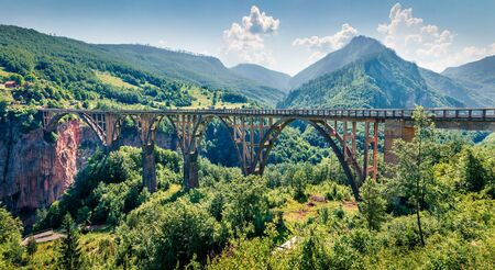 Attractive morning view of Djurdjevica bridge over the river Tara. Bright summer scene of Montenegro, Europe. Beautiful world of Mediterranean countries. Traveling concept background. Stok Fotoğraf