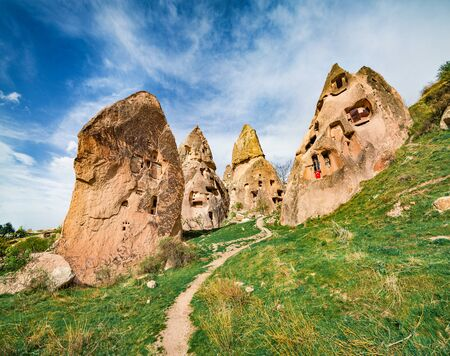 Sunny summer landscape of Cappadocia. Early morning in the Uchisar Castle neighborhood. Great outdoor scenew in famous Uchisar village, district of Nevsehir Province, Turkey, Asia. 版權商用圖片