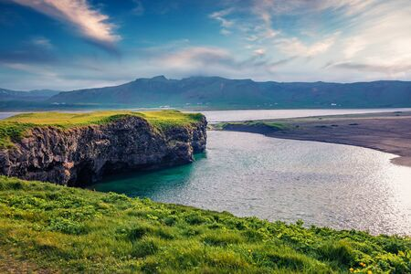 Impressive summer view of Dyrholaey Nature Reserve. Splendid morning view of south coast of Iceland, Europe. Beauty of nature concept background. 写真素材