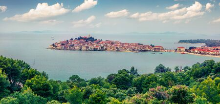 Panoramic summer view of Primosten town. Marvelous morning seascape of Adriatic sea, Croatia, Europe. Beautiful world of Mediterranean countries. Traveling concept background. Stock Photo