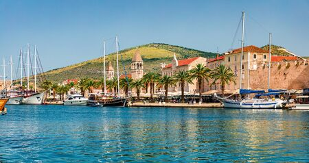 Romantic summer cityscape of Trogir town. Sunny morning seascape of Adriatic sea. Beautiful world of Mediterranean countries. Traveling concept background.