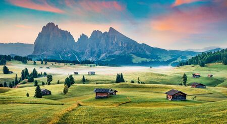 Breathtaking morning scene of Compaccio village, Seiser Alm or Alpe di Siusi location, Bolzano province, South Tyrol, Italy, Europe. Fantastic summer sunrise of Dolomiti Alps.