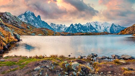 Panoramic morning view of Cheserys lake with Mount Blanc on background, Chamonix location. Fantastic  autumn sunrise in Vallon de Berard Nature Preserve, Alps, France, Europe.