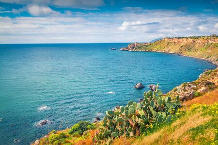 Sunny morning view of Milazzo cape with nature reserve Piscina di Venere, Sicily, Italy, Europe. Splendid summer seascape of Mediterranean sea. Beauty of nature concept background.