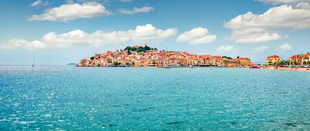 Panoramic summer view of Primosten town. Captivating morning seascape of Adriatic sea, Croatia, Europe. Beautiful world of Mediterranean countries. Traveling concept background.