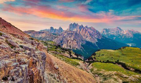 Unbelievable summer sunrise in National Park Tre Cime di Lavaredo with Cadini di Misurina range and Sorapis group on background. Fantastic morning view of Dolomiti Alps, Italy, Europe.