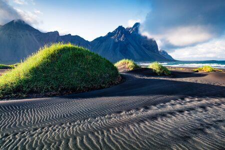 Fantastic summer scene of black sand dunes on the Stokksnes headland on southeastern Icelandic coast. Iceland, Europe. Beauty of nature concept background. Foto de archivo