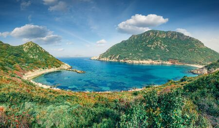 Sunny summer view of Pirates Bay, Porto Timoni, Afionas village location. Splendid morning seascape of Ionian Sea. Colorful outdoor scene of Corfu island, Greece, Europe. Traveling concept background. Stock Photo