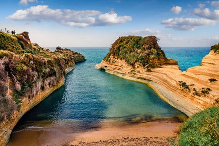 Wonderful spring view of famous Channel Of Love (Canal d'Amour) beach. Bright morning seascape of Ionian Sea. Amazing outdoor scene of Corfu Island, Greece, Europe.