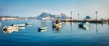 Panoramic morning view of the old Venetian fortress in Kerkira, capital of Corfu island. Sunny summer seascape of Ionian Sea, Greece, Europe. Traveling concept background. Stock Photo