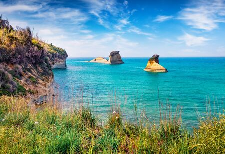 Colorful spring view of Sidari village, famous Channel Of Love (Canal d'Amour) beach location. Bright morning seascape of Ionian Sea. Sunny outdoor scene of Corfu Island, Greece, Europe.  Stock Photo