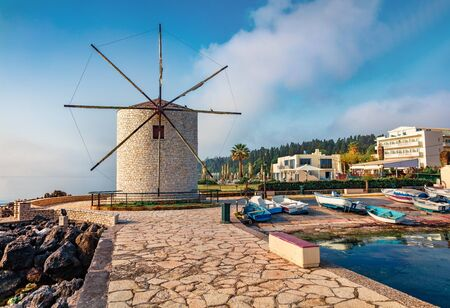 Stunning morning view of old windmill (Anemomilos). Sunny summer cityscape of Kerkira tovn, capital of Corfu island, Greece, Europe. Traveling concept background.