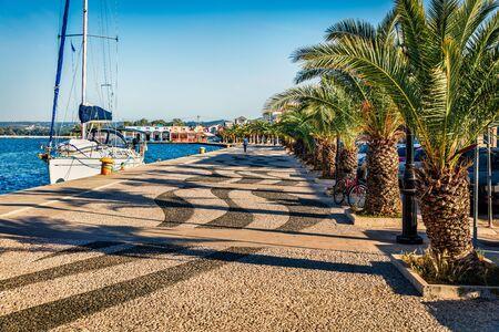 Attractive spring cityscape of Argostoli port. Romantic morning scene of Kefalonia island, Greece, Europe. Beautiful seascape of Ionian Sea. Traveling concept background.