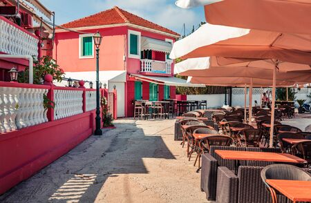 Colorful summer cityscape of Fiskardo town, Ionian Island. Captivating outdoor scene of Kefalonia island, Greece, Europe. Traveling concept background.