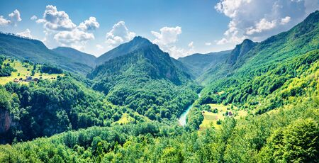 Incredible view opens from the Djurdjevica bridge over the Tara river. Bright morning view of Montenegro, Europe. Beautiful world of Mediterranean countries. Traveling concept background.