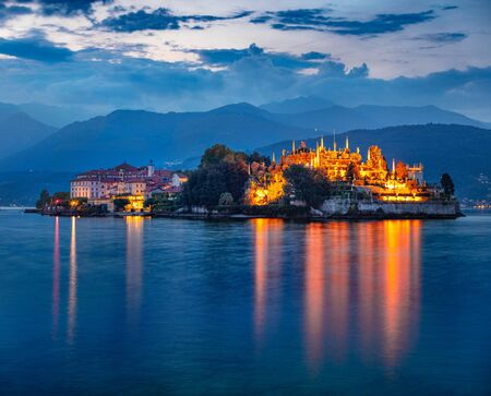 Fantastic evening cityscape of Stresa town. Splendid summer night on Maggiore lake with Bella island on background, Province of Verbano-Cusio-Ossola, Italy, Europe. Traveling concept background. 写真素材