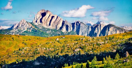 Panoramic morning view of Sass de Stria peak, Averau - Nuvolau group from Giau pass. Sunny summer scene of Dolomiti Alps, Italy, Europe. Beauty of nature concept background.
