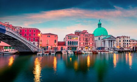 Impressve spring sunrise in Venice with San Simeone Piccolo church. Fantastic morning scene in Italy, Europe. Exciting Mediterranean landscape. Traveling concept background.