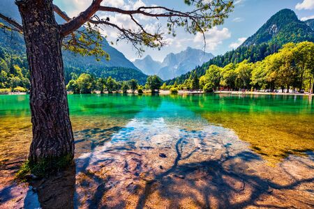 Sunny summer scene of Julian Alps, Gozd Martuljek location, Slovenia, Europe. Marvelous morning view of Jasna lake. Picturesque landscape of Triglav National Park. Traveling concept background. Imagens