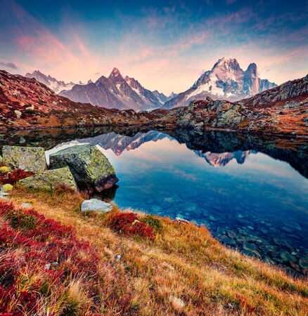 Impressive sunset in Vallon de Berard Nature Preserve, Graian Alps, France, Europe. Amazing autumn view of Cheserys lake/Lac De Cheserys, Chamonix location. Beauty of nature concept background.