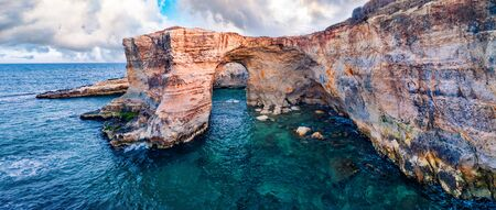 View from flying drone. Aerial spring view of popular tourist attraction - Torre Sant'Andrea. Panoramic morning seascape of Adriatic sea, Torre Sant'Andrea village location, Apulia region, Italy, Europe.