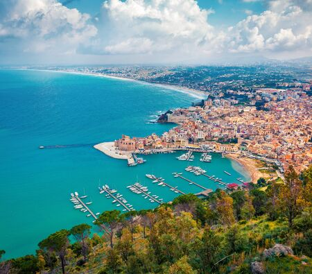 Colorful morning cityscape of of Castellammare del Golfo town. Sunny spring seascape of Mediterranean sea. Picturesque scene of Sicily, Trapani Province, Europe. Traveling concept background.