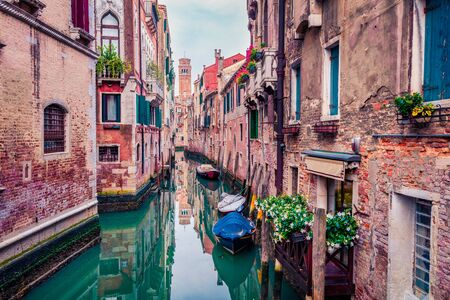 Marvelous summer cityscape of Vennice with famous water canal and colorful houses. Calm morning scene of Italy, Europe. Traveling concept background.