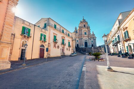 Bright spring scene of Piazza Duomo with Duomo San Giorgio - baroque Catholic church. Wonderful morning cityscape of Ragusa, Sicily, Italy, Europe. Traveling concept background.