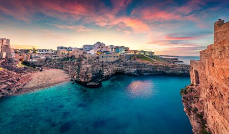 Unbelievable spring cityscape of Polignano a Mare town, Puglia region, Italy, Europe. Marvelous evening seascape of Adriatic sea. Traveling concept background.