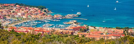 Panoramic spring cityscape of Palau port, Province of Olbia-Tempio, Italy, Europe. Aerial morning scene of Sardinia island. Sunny mediterranean seascape. Traveling concept background.
