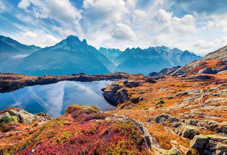 Astonishing autumn view of Chesery lake/Lac De Chesery, Chamonix location. Breathtaking outdoor scene of Vallon de Berard Nature Preserve, Graian Alps, France, Europe.