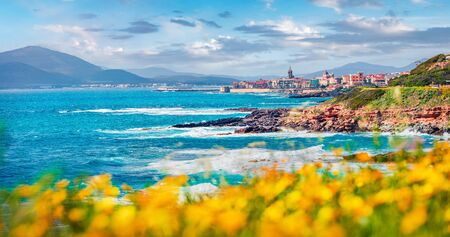 Superb spring cityscape of Alghero town. Sunny morning scene of Sardinia island, Italy, Europe. Bright Mediterranean seascape. Traveling concept background.