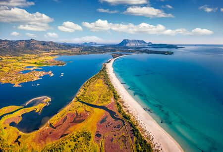 View from flying drone. Stunning spring view of La Cinta beach. Splendid morning scene of Sardinia island, Italy, Europe. Aerial Mediterranean seascape. Beauty of nature concept background. Imagens