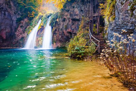 Speakling water flowing down in waterfall in Plitvice National Park. Superb autumn scene of Croatia, Europe. Abandoned places of Plitvice lakes series. Beauty of nature concept background.