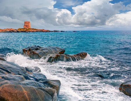 Dramatic spring view of Torre di Bari tower. Splendid morning scene of Sardinia island, Italy, Europe. Amazing seascape of Mediterranean sea. Beauty of nature concept background.