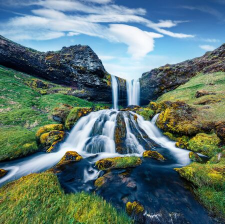 Wonderful summer view of Sheep's Waterfall. Spectacular morning scene of Iceland, Europe. Beauty of nature concept background.