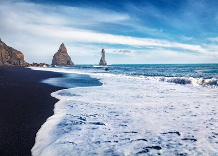 Splendid morning seascape of Atlantic ocean. Stunning view of Reynisdrangar cliffs. Impressive summer scene of Iceland, Vik location, Europe. Beauty of nature concept background.