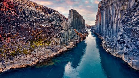 View from flying drone of Studlagil Canyon. Superb morning landscape of Jokulsa A Bru river. Great summer scene of Iceland, Europe. Beauty of nature concept background. Stock Photo