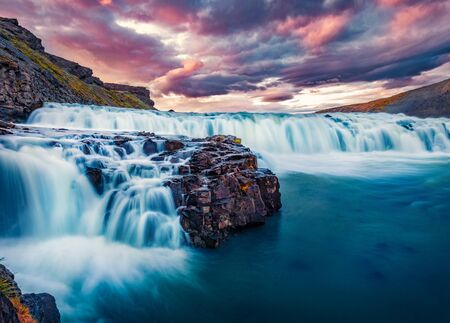 Dramatic morning view of popular tourist destination - Gullfoss waterfall. Fantastic summer sunrise on Hvita river. Colorful outdoor scene of Iceland, Europe. Beauty of nature concept background.