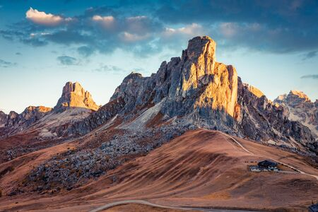 Gorgeous morning view from the top of Giau pass with famous Ra Gusela, Nuvolau peaks in background. Captivating autumn scene of Dolomite Alps, Cortina d'Ampezzo location, Italy, Europe.