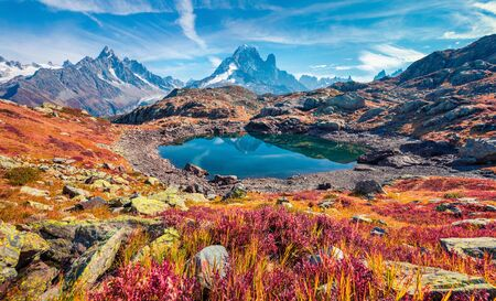 Exciting autumn view of Cheserys lake (Lac De Cheserys), Chamonix location. Superb morning scene of Vallon de Berard Nature Preserve, Graian Alps, France, Europe.