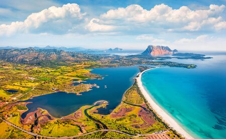 View from flying drone. Incredible spring view of La Cinta beach. Aerial morning scene of Sardinia island, Italy, Europe. Sunny Mediterranean seascape. Beauty of nature concept background. Imagens