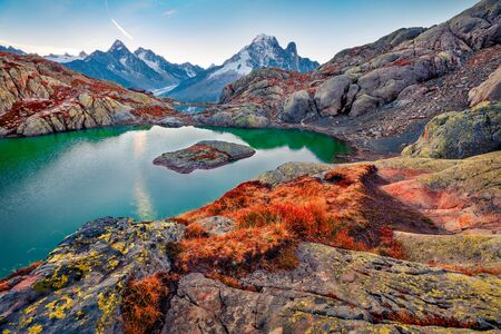 Captivating autumn view of Lac Blanc lake with Mont Blanc (Monte Bianco) on background, Chamonix location. Great outdoor scene of Vallon de Berard Nature Preserve, Graian Alps, France, Europe.