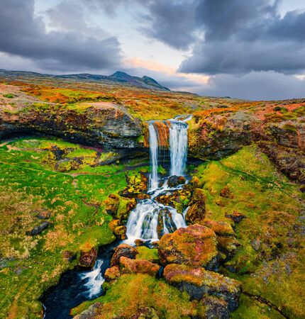 View from flying drone. Stunning morning scene of Sheep's Waterfall. Aerial summer view of Iceland, Europe. Beauty of nature concept background.