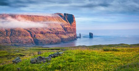 Astonishing summer scene of popular tourist attraction - Risin og Kellingin cliffs. Panaramic morning view of Eysturoy island. Great seascape of Atlantic ocean, Faroe Islands, Denmark, Europe.