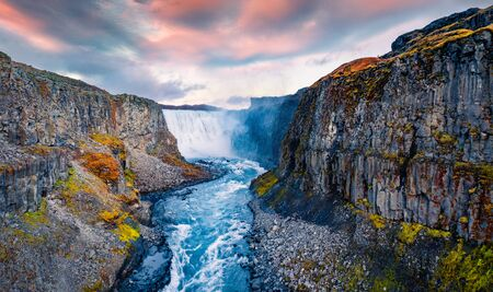 View from down of canyon of most powerful waterfall in Europe - Dettifoss. Splendid summer sunrise in Jokulsargljufur National Park, Iceland. View from flying drone.