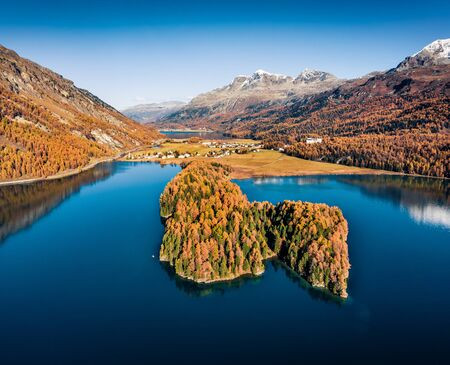View from flying drone. Breathtaking autumn view of Sils lake. Exciting morning scene of Swiss Alps. Great outdoor scene of Switzerland, Europe. Beauty of nature concept background.