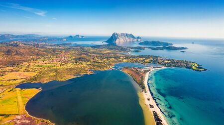 View from flying drone. Awesome summer view of La Cinta beach. Perfect morning scene of Sardinia island, Italy, Europe. Aerial Mediterranean seascape. Beauty of nature concept background. Imagens