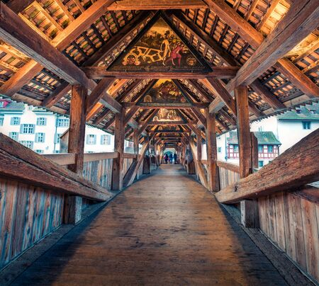 Famous old wooden Spreuer Bridge, 15th-century, covered pedestrian bridge featuring a series of paintings with a death motif. Lucerne cityscape, Switzerland, Europe. Traveling concept background. Archivio Fotografico