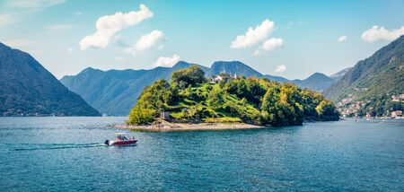Bright morning view of Comocina island from the hiil of Ossuccio village, Province of Como, region Lombardy, Italy, Europe. Wonderful summer scene of Como lake. Traveling concept background.